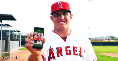 MLB superstar and official spokesperson Mike Trout shows off his digital card in Topps BUNT 2014.