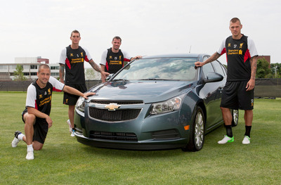"""Liverpool FC players (l to r) Joe Cole, Daniel Agger, Jamie Carragher and Martin Skrtel in Boston, Mass., with a Chevrolet Cruze. Global auto maker, Chevrolet is entering into a four-year partnership agreement with the Barclays Premier League giant Liverpool FC to become the Club's Global Official Automotive Partner, which includes the designation of """"Official Sponsor of the LFC North American Tour 2012."""" (Photo by Steve Haines for Chevrolet).  (PRNewsFoto/General Motors)"""