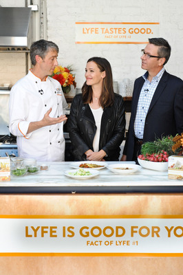 LYFE Kitchen Vice President of Product Development John Mitchell (left) and Founder Stephen Sidwell (right) welcome LYFE Kitchen's newest brand ambassador, actress and philanthropist Jennifer Garner. Garner spoke about how strongly she believes in the importance of serving great-tasting, healthy and affordable food to active families, all core principles of the LYFE Kitchen brand. Photo by Liza Gershman.