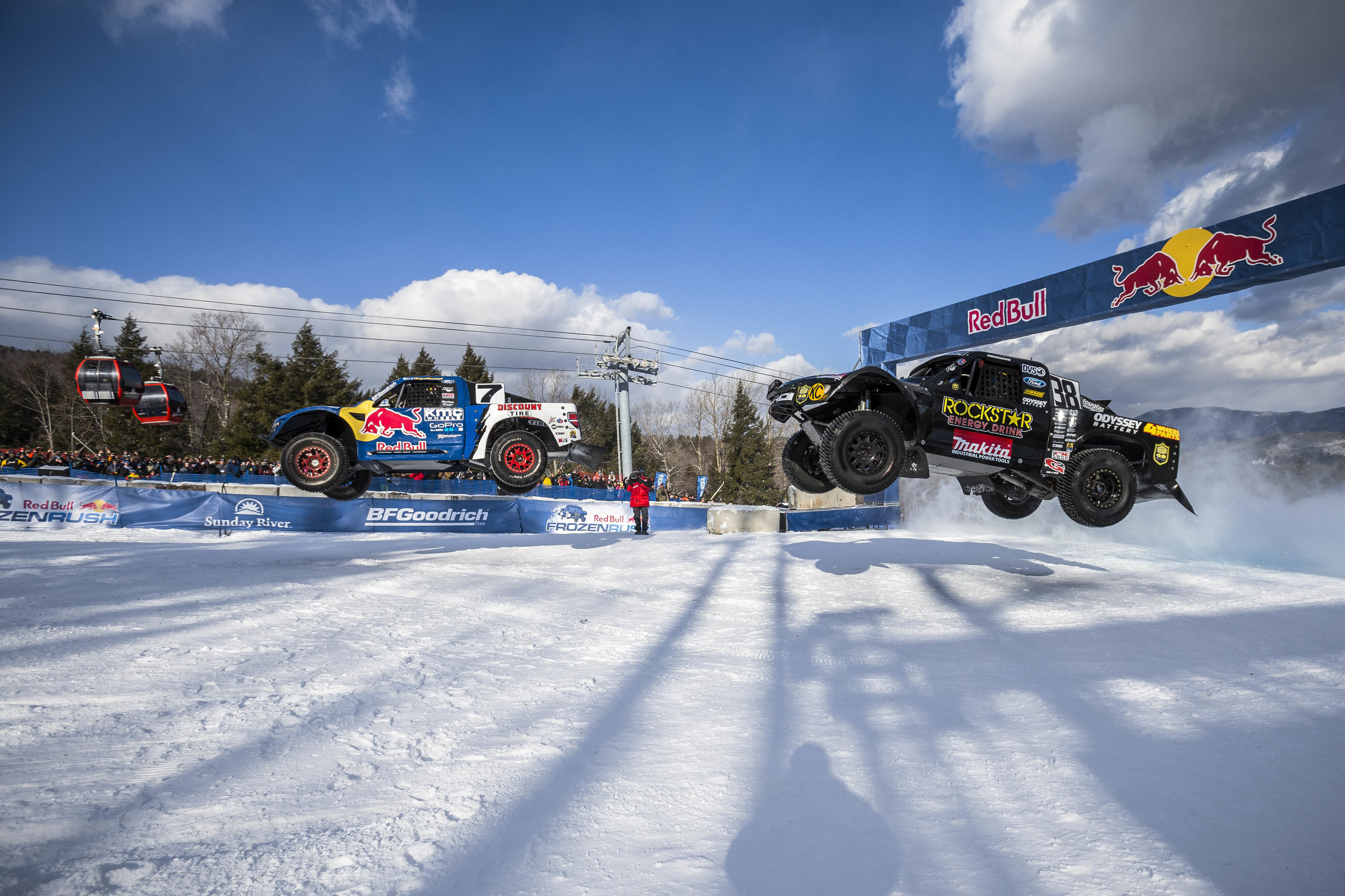 Off-road trucks race head-to-head on snow for Red Bull Frozen.