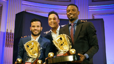 Rawlings Gold Glove Award winners for second basemen, Jose Altuve of the Houston Astros(TM) (left) and Dee Gordon of the Miami Marlins(TM) (right) presented by Roberto Alomar at the Rawlings Gold Glove Awards in New York City on November 13, 2015.