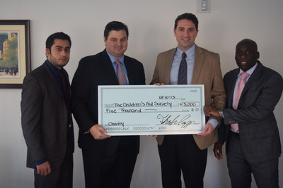 NILICO-Kevin Allan (second from right), Children's Aid Society Chief Development Officer with National Income Life's Salman Quadri, SGA Theo Pappas and Levar Morgan