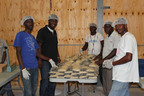 "Mission of Hope, Haiti announces the first large-scale packaging of commodities purchased from Haitian farmers to feed hungry children in local schools and orphanages. Buying from local farmers is an important milestone in MOH's agronomy program, which began two years ago with education and seed distribution for 2,300 Haitian farmers. ""For the first time, we are growing food in Haiti, purchasing food in Haiti, packing food in Haiti, and then using it to feed students and orphans in need,"" says Brad Johnson, President of Mission of Hope.  (PRNewsFoto/Mission of Hope, Haiti)"
