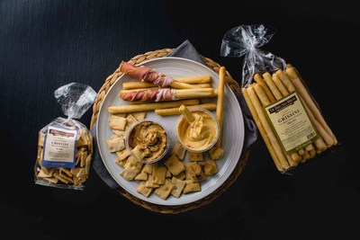 Announcing two new booze flavored cheese spreads including Pinot Grigio & Fig | Smoked Gouda & Beer.  These two unique flavors are the first new spreads that we've added to the lineup in over a decade! Pinot Grigio & Fig Cheese Spread has Aged Cheddar, White Wine, and Sweet Figs and Smoked Gouda & Beer with Pimentos Cheese Spread has nutty smoked Gouda, pimentos & a splash of brown ale. Serve with Di Bruno Bros. new Grissini breadsticks and new Sea Salt Crostini!