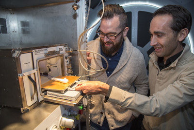 Kyle Nel, executive director, Lowe's Innovation Labs, left, and Jason Dunn, CTO and co-founder, Made in Space, examine a 3D printer in a mock-up of the International Space Station (ISS) in New York on Wednesday, October 28, 2015. Lowe's Innovation Labs (http://www.lowesinnovationlabs.com), the disruptive innovation hub of Lowe's Companies, Inc., has partnered with aerospace company Made in Space, to become the first to launch a commercial 3D printer to space.  The printer, the first permanent additive manufacturing facility for the ISS, will bring tools and technology to astronauts in space.