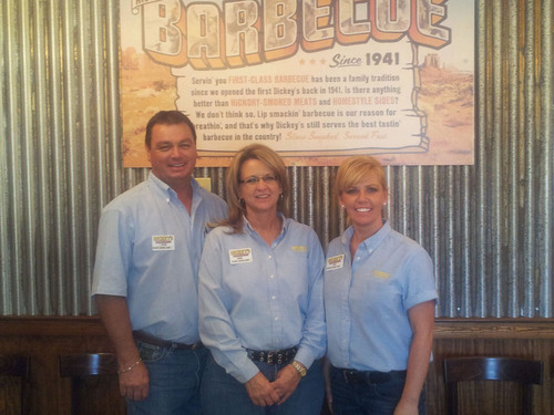 Dickey's local franchise owner Nikki and Alan Wisdom are ready to open their new location in Levelland, TX with the help of their general manager Amy Day (far right).  (PRNewsFoto/Dickey's Barbecue)