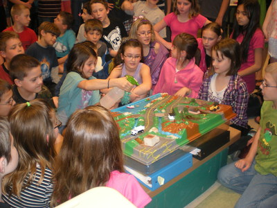 Fourth grade students at Northwestern Elementary School in Pennsylvania learn about the water cycle from Nestle Waters volunteers at a World Water Day event.