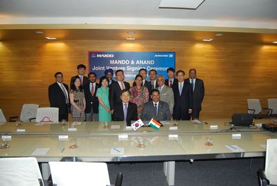 Seated (L to R): Frank Chung, Executive VP, Corporate Planning, Mando Corp.; Pravesh K Srivastava, Group President, Excellence in Manufacturing & Education, Anand. Standing First Row (L to R): Christine Chung; Jaisal Singh, Director, Anand Supervisory Board; Mrs IH Honng, MW Chung, Chairman, Mando Corp.; Mrs Anjali Singh, Chairperson, Anand Supervisory Board; Deep C Anand, Founder Anand & Chairman Deep C Anand Foundation; SH Shin, Vice Chairman & CEO, Mando Corp. 2nd Row: Deepak Chopra, Group CEO, Anand; YH Lee; KS Bhullar, President Group HR, Anand; KS Kim, President, Global Sales Marketing, Mando Corp.; JW Son, Regional Head MD, Mando; Sejoon Oh, Managing Director, Softech; V Madhavan, Deputy Managing Director, Mando India Limited
