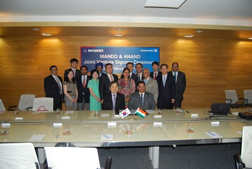 Seated (L to R): Frank Chung, Executive VP, Corporate Planning, Mando Corp.; Pravesh K Srivastava, Group President, Excellence in Manufacturing & Education, Anand. Standing First Row (L to R): Christine Chung; Jaisal Singh, Director, Anand Supervisory Board; Mrs IH Honng, MW Chung, Chairman, Mando Corp.; Mrs Anjali Singh, Chairperson, Anand Supervisory Board; Deep C Anand, Founder Anand & Chairman Deep C Anand Foundation; SH Shin, Vice Chairman & CEO, Mando Corp. 2nd Row: Deepak Chopra, Group CEO, Anand; YH Lee; KS Bhullar, President Group HR,  ...