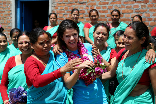 UNICEF Ambassador, Selena Gomez embraces the women of the Paralegal Committee and the Gender Based Violence Watch Group after hearing of their UNICEF-supported work, to mediate cases of conflict, divorce, domestic violence, child abuse and more. Photo Credit: Courtesy of U.S. Fund for UNICEF/Josh Estey/MatiHati (PRNewsFoto/U.S. Fund for UNICEF)