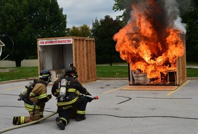 Side-by-side fire and sprinkler burn demonstration at Moraine Valley Community College (Palos Hills, Ill.) during Fire Prevention Month 2016.