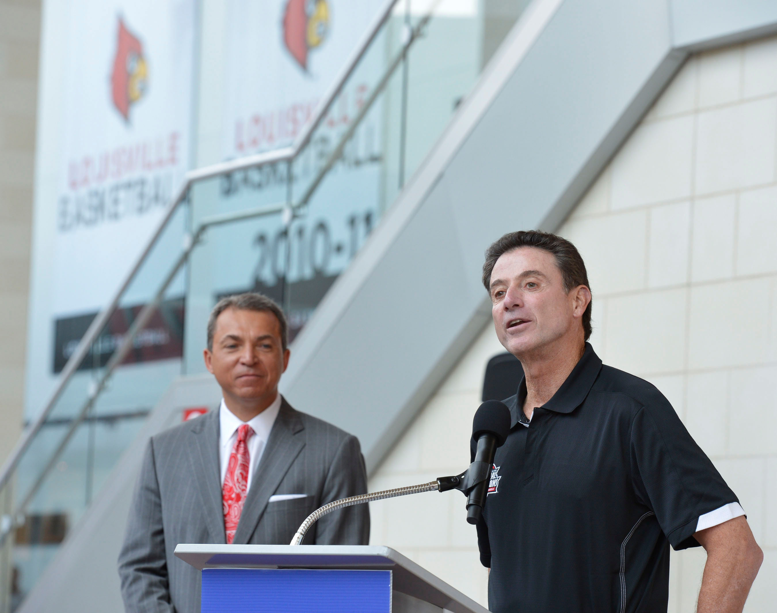 Dan Rivers (left), Northwestern Mutual managing partner for Kentucky, and University of Louisville Head Coach Rick Pitino (right) announce the 2013 NCAA Championship Floor sale. Pieces of the floor will be sold this fall to raise money for the fight against pediatric cancer.  (PRNewsFoto/Northwestern Mutual)