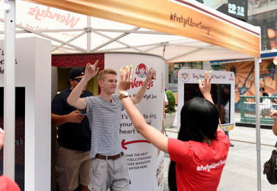 "Wendy's is setting up its #PretzelLoveSongs Karaoke Booth at historic Navy Pier in Chicago for fans to sing their hearts out for the return of Wendy's Pretzel Bacon Cheeseburger and Pretzel Pub Chicken sandwiches. Pretzel bun fans will be able to create a music video singing ""pretzelfied"" love song lyrics to share online with their pretzel groupies. (Photo by Larry Busacca / Getty Images for Wendy's) (PRNewsFoto/The Wendy's Company)"