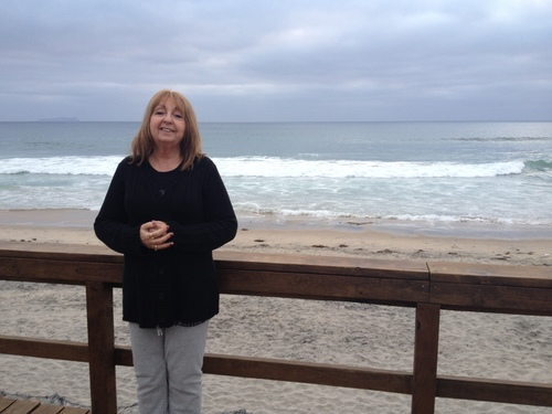 Rivi Litvin by the Pacific Ocean boardwalk next to Hope4Cancer Institute in Mexico. Rivi overcame stage 4 ...