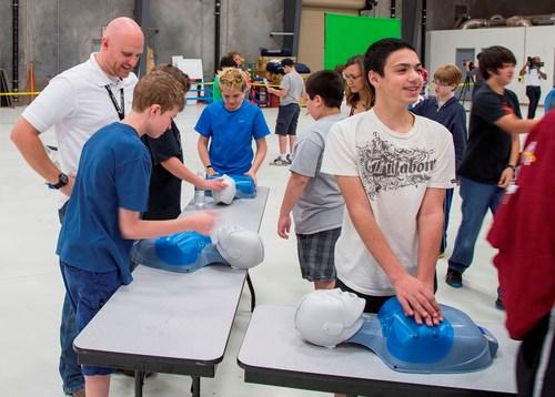Students from Gateway Academy learn lifesaving techniques from Angel MedFlight staff. (PRNewsFoto/Angel MedFlight)