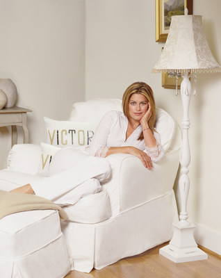 """This exclusive media image shows Kathy in a monochromatic design vignette featuring, pillows from kathy ireland(R) Home by Nourison and kathy ireland(R) Home lighting from Pacific Coast Lighting beside kathy ireland(R) Home Slipcovers by MADISON, all brand extensions of kathy ireland(R) Home, a kathy ireland(R) Worldwide brand. Pajamas by kathy ireland(R) Sleepwear, PPI, NY,  jewelry from Diamonds by kathy ireland(R), Paul Raps, New York."""""""