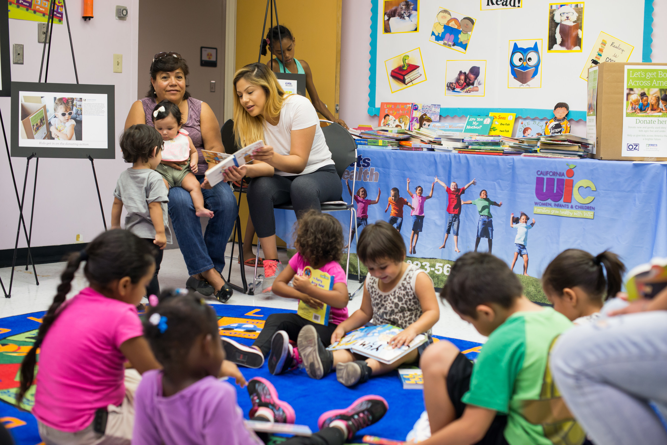 Children and families at the Watts Healthcare Corporation: WIC in Watts, CA receive their book donations as part of the nationwide Books Across America book drive that collected nearly 45,000 children's book donations.