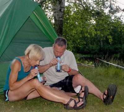 Campers use lightweight LifeStraw water filter to get safe drinking water away from home.(PRNewsFoto/Vestergaard Frandsen, Adam Stoltman)