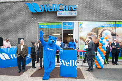 Blu, WellCare of New York's mascot, strikes a post outside WellCare's newest Welcome Center at 1365 Saint Nicholas Avenue in Manhattan's Washington Heights. WellCare Welcome Centers are neighborhood health information, education and activity centers.