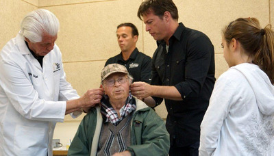 Harry Connick Jr. (pictured center, with Bill Austin, far left). Assisting in the coordination and planning of the mission was Physicians for Human Rights-Israel, which was also involved in the 2011 Israel-Palestine mission.  (PRNewsFoto/Starkey Hearing Foundation)
