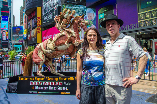 (Right to Left) German anatomist and creator of Body Worlds, Dr. von Hagens and exhibition curator Angelina Whalley. Dr. von Hagens' iconic Rearing Horse and Rider made its first ever public appearance in Times Square Tuesday, July 24 before making its permanent home in the Body Worlds exhibit at  Discovery Times Square in New York.  (PRNewsFoto/Discovery Times Square)