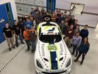 Students from Bullock Creek High School pose with the TI Automotive No. 93 Dodge Viper SRT display car at the TI Automotive Technical Center in Auburn Hills, Mich. on May 13, 2015.