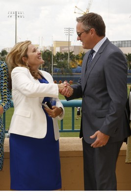 AARP President Lisa Marsh Ryerson and Dolphins President & CEO Tom Garfinkel. (PRNewsFoto/AARP Foundation)