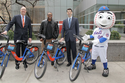 (L-R): Jay Walder, CEO, Motivate; Curtis Granderson, Mets outfielder; Ed Skyler, Head of Global Public Affairs, Citi; and Mr. Met pose during launch of Citi Perks Sweepstakes. Mets outfielder Curtis Granderson helped Citi launch the Citi Perks Sweepstakes in midtown today, with 350 bikes from Citi Bike with Mets-themed branding across New York City. On April 7, 2016 in New York City. (Photo by Bennett Raglin/Getty Images for Citi)