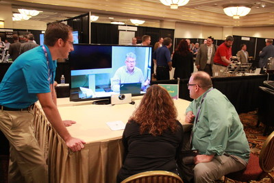 Attendees take part in a hands-on Cisco SpeakerTrack demonstration at NY Tech Summit