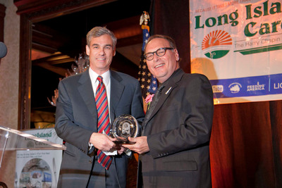 NBTY CEO Jeff Nagel (left) accepts the Harry Chapin Humanitarian Award for Corporate Leadership from Paul Pachter, Executive Director of Long Island Cares, Inc. (right).  (PRNewsFoto/NBTY, Inc.)