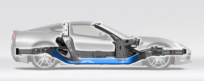 Backbone of the lightweight aluminum 2014 Corvette Stingray frame is a set of hydroformed aluminum tube center sections from Vari-Form (blue highlight), bridging the gap between two pairs of connecting nodes and front/rear crush-zones.  (PRNewsFoto/Vari-Form)