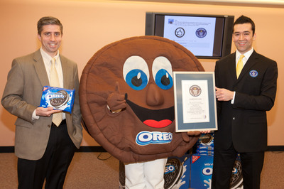 "Guinness World Records Corporate Adjudications Manager Danny Girton Jr. (R) awards Senior Director, Oreo Global Growth Platforms for Kraft Foods John Ghingo (L) and Oreo Man (C) with the Title Certificate for Oreo setting the Guinness World Records mark for ""Most Likes on a Facebook Post In 24 Hours"" at Kraft Foods on Wednesday, February 16th, 2011 in East Hanover, New Jersey. Oreo set the mark with 114,619 ""Likes,"" becoming the World's ""Most-Liked"" Cookie on Facebook. (Matt Peyton/AP Images for Nabisco).  (PRNewsFoto/Kraft Foods Inc.)"