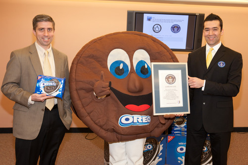 "Guinness World Records Corporate Adjudications Manager Danny Girton Jr. (R) awards Senior Director, Oreo Global Growth Platforms for Kraft Foods John Ghingo (L) and Oreo Man (C) with the Title Certificate for Oreo setting the Guinness World Records mark for ""Most Likes on a Facebook Post In 24 Hours"" at Kraft Foods on Wednesday, February 16th, 2011 in East Hanover, New Jersey. Oreo set the mark with 114,619 ""Likes,"" becoming the World's ""Most-Liked"" Cookie on Facebook. (Matt Peyton/AP Images for Nabisco).  ..."