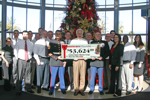 Stater Bros. President and COO Pete Van Helden (center) and others from Stater Bros. Corporate Offices present a check from Stater Bros. Charities to the United States Marine Corps Toys for Tots Program. Accepting the check were USMC Gunnery Sergeant Kian Adyani (left) and USMC Captain Michael Gocke. (PRNewsFoto/Stater Bros. Charities) (PRNewsFoto/STATER BROS. CHARITIES)