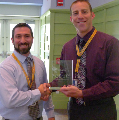 Milton Hershey School(R) Principal Skip Weber(R) presents the CORE Residential Educator of the Year Award to Teacher David Curry, who teaches Law, Public Safety, and Security at the School.  (PRNewsFoto/Milton Hershey School)