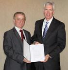 TELDAT President and CEO Henryk Kruszynski and Daniel J Crowley, President, Raytheon Integrated Defense Systems (PRNewsFoto/Raytheon Company)
