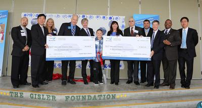 Hyundai Motor America's president and CEO John Krafcik and chief executive coordinator B.H. Lee and other Hyundai executives present the Fountain Valley School District with a grant to implement MIND's ST Math(R) education program at Robert Gisler Elementary School in Fountain Valley, California on December 13, 2012.  (PRNewsFoto/Hyundai Motor America)