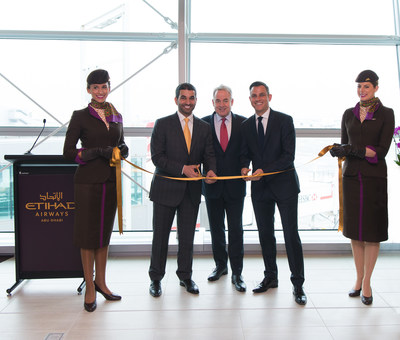 Etihad Airways President and Chief Executive Officer James Hogan is joined in a ribbon-cutting ceremony inaugurating the airline's new premium First and Business Class Lounge at New York's John F. Kennedy International Airport by Hareb Almuhairy, Senior Vice President, Corporate and International Affairs (L), Martin Drew, Senior Vice President, The Americas (R) and Etihad Airways' cabin crew.