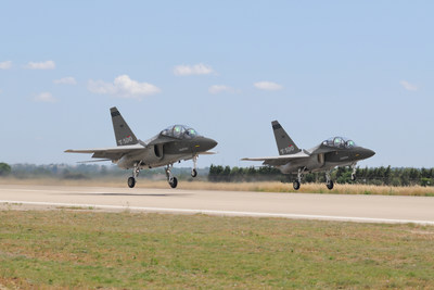 A pair of T-100 jet trainers taking off