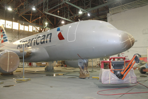 Fresh coat of paint for N700UW, the first US Airways aircraft in American livery. (PRNewsFoto/American ...