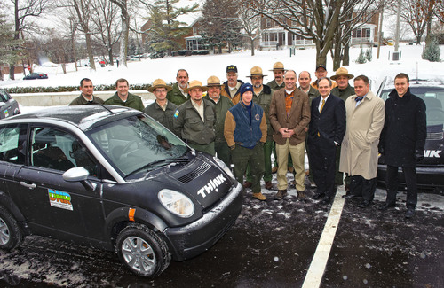 From the left in the center of the photo are Governor Mitch Daniels, Indiana DNR Director Robert Carter, THINK CEO Barry Engle, Indiana Department of Administration Commissioner Robert Wynkoop and Energy Systems Network CEO Paul Mitchell along with representatives from the 12 state parks receiving THINK City cars.  (PRNewsFoto/THINK)