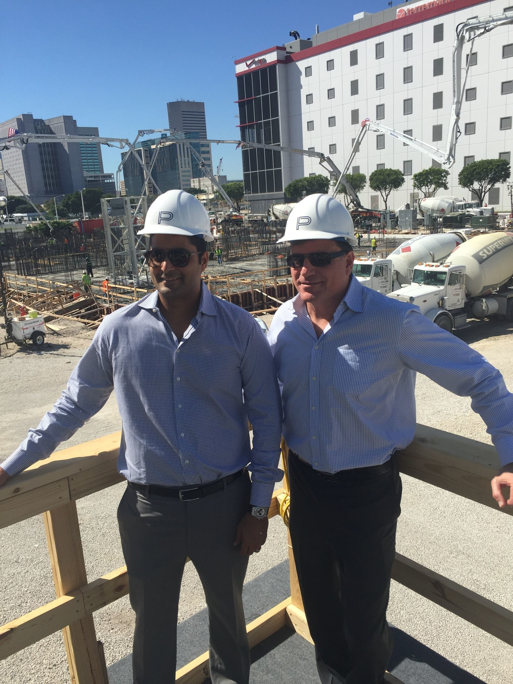 """Nitin Motwani, Managing Principal, Miami Worldcenter (LEFT) and Daniel Kodsi, Paramount Miami Worldcenter (RIGHT) with """"Big Pour"""" Foundation in Background"""