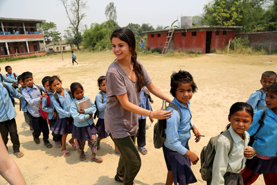 UNICEF Ambassador, Selena Gomez walks with students from an early childhood development classroom at Shree Dharmabhakta Secondary School in Dhadhawa village/Bardiya district, as they depart at the end of their school day. Photo Credit: Courtesy of U.S. Fund for UNICEF/Josh Estey/MataHati (PRNewsFoto/U.S. Fund for UNICEF, Josh Estey/MataHati)
