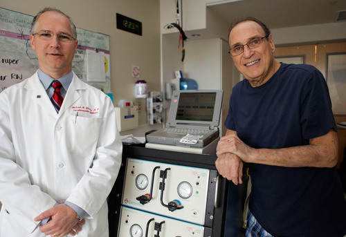 Jim Carelli, Jr. (right), the first patient in New England to receive the SynCardia Total Artificial Heart, pictured with Dr. Michael Givertz, medical director of the Heart Transplant and Mechanical Circulatory Support Program at Brigham and Women's Hospital in Boston.  (PRNewsFoto/SynCardia Systems, Inc.)