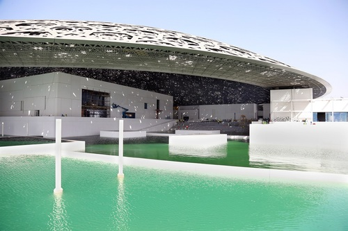 Temporary walls removed to allow the sea to surround the building, realising the architect's vision for the ...