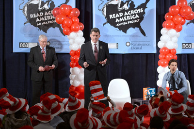 Renaissance Dental CEO Rob Mulligan, flanked by NEA President Dennis Van Roekel and actor Jake T. Austin, joins hundreds of elementary school children and the Cat In the Hat to celebrate NEA's annual Read Across America Day at New York Public Library. Renaissance Dental is teaming up with NEA's Read Across America for a second year to encourage children to develop good oral health and literacy habits.  (PRNewsFoto/National Education Association)