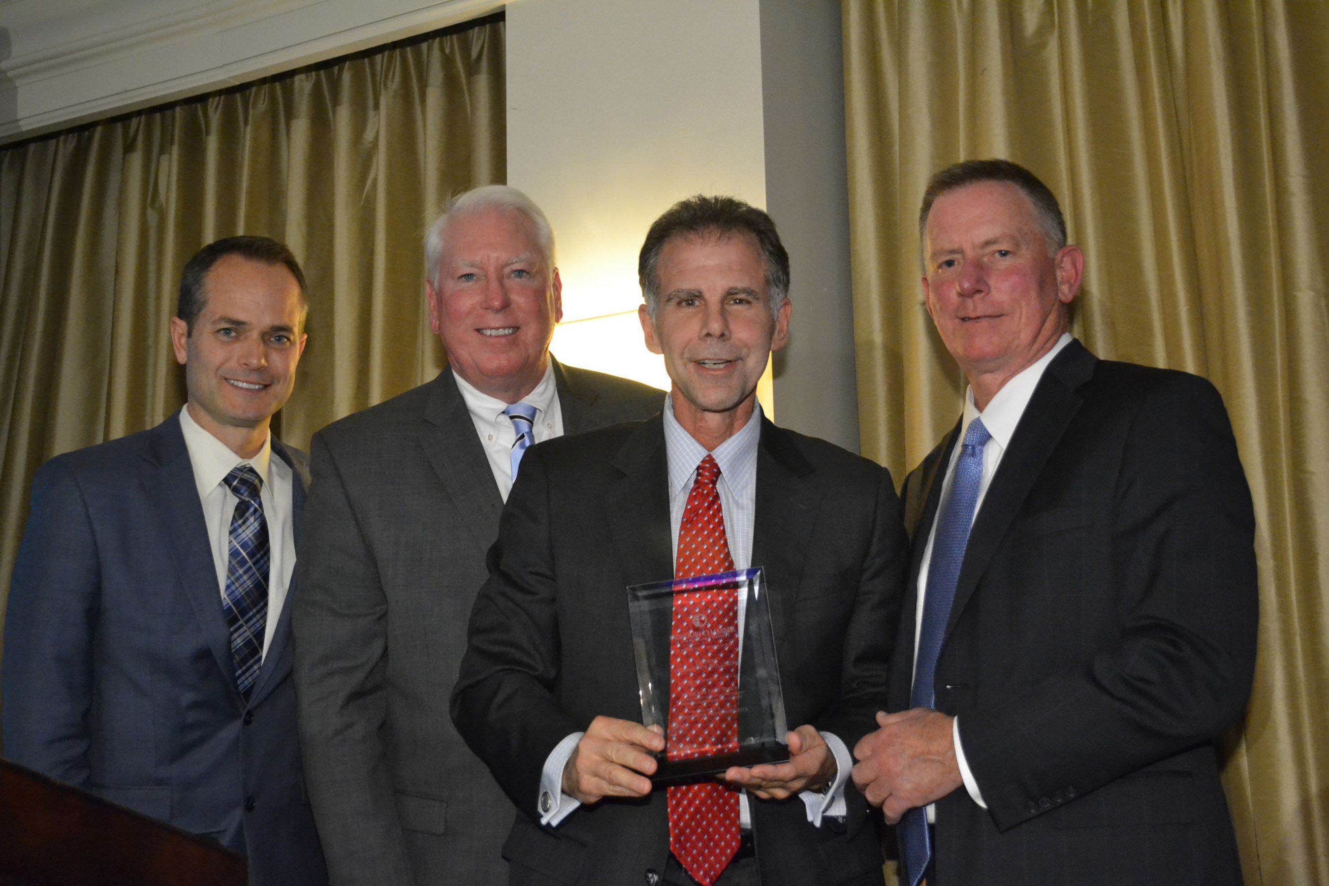 President Dann Adams accepts the 2015 Fast Track Award on behalf of Equifax Workforce Solutions.