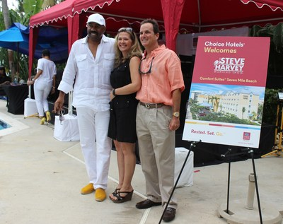 Steve Harvey with Angel and Gary Rutty, Managing Director of Comfort Suites Seven Mile Beach