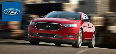 Toliver Ford examines the Ford Taurus (PRNewsFoto/Toliver Ford)