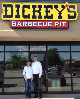 Brandi and Brandon Kosek outside their first Dickey's Barbecue Pit location in Bellevue. Grand opening kicks off Thursday with the first 50 dine-in guest receiving gift cards worth up to $50. (PRNewsFoto/Dickey's Barbecue)